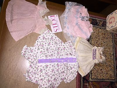Lot of vintage style and vintage dresses for antique dolls