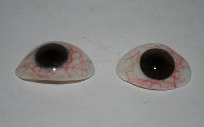 two vintage German human prosthetic glass eyes, brown