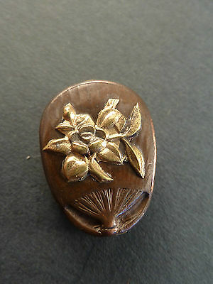 JAPANESE MIXED METAL OJIME BEAD IN THE FORM OF A FAN. Signed.