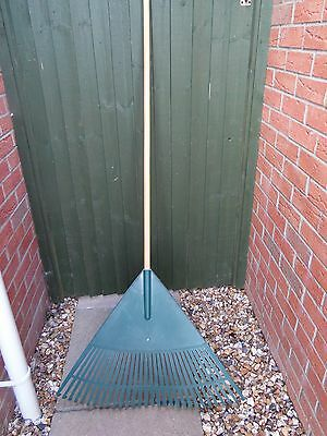 Large Leaf / Lawn Rake. Plastic Head, Wooden Handle. Very Good Condition.