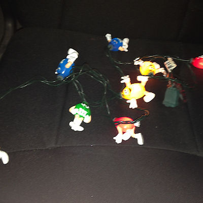 String of M & M's candy figures lights party christmas.