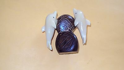 2 Vegetable Ivory Carved Dolphins