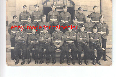 Kings Own Scottish Borderers group photo postcard in front of Gaza building