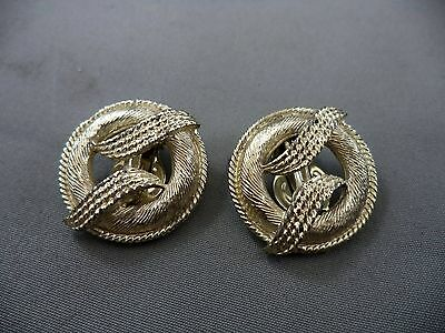 Nice Gold Tone Texturized Ribboned Accent Round Clip On Earrings