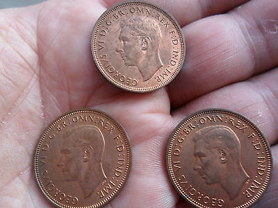 wartime halfpenny coins of King George VI 1944 x 3 toned with lustre aUNC.
