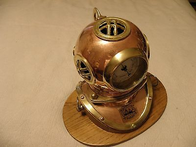 Copper and brass navy diving helmet replica on a hardwood base