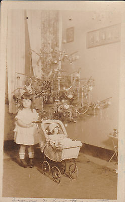 Christmas Real Photo Postcard With Girl With New Doll And Doll Buggy.