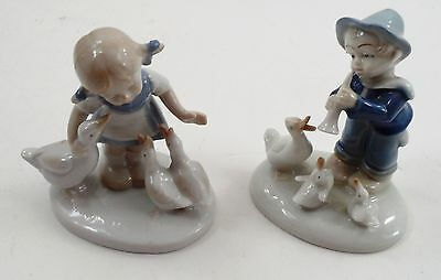 2 German Lippelsdorf GDR Figurines Boy Playing Lute to Geese & Little Goose Girl