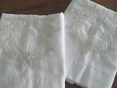 Vintage hand embroidered pillowcase pair, ornate ivory crest on white