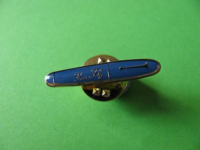Small Yves Foly Pen Pin Badge. Good Condition.