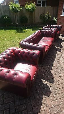 An ox blood red leather Chesterfield 3 piece suite in good condition throughout