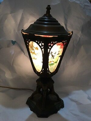 An Old Cast Metal Table Lamp & Painted Glass Panels