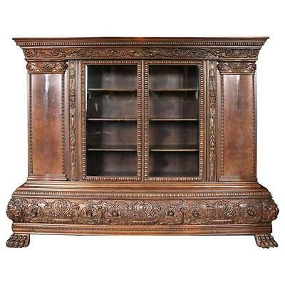 Monumental Carved German Baroque Walnut and Burl four-Door three-Drawer Bookcase