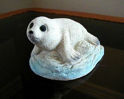 White Baby Seal Sitting On Ice Figurine Made By American Sand Art