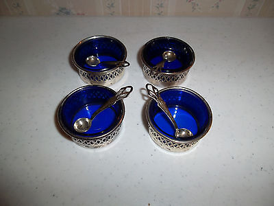 FOUR VINTAGE COBALT BLUE GLASS and STERLING SILVER OPEN SALT CELLARS with SPOONS