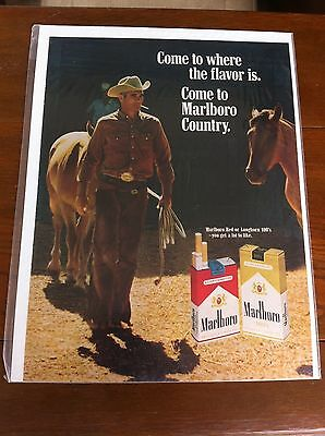 Vintage 1968 Marlboro Cigarettes Cowboy Walking Out Of Stable Horses Print ad