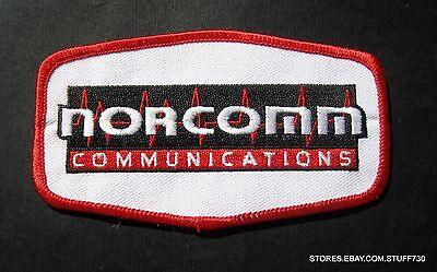 NORCOMM COMMUNICATIONS EMBROIDERED SEW ON PATCH ADVERTISING BADGE 4 1/2 x 2 1/2