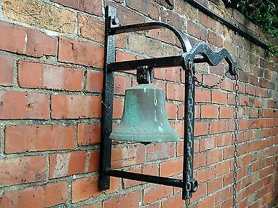Large antique possibly Victorian bronze school yard calling bell in iron holder