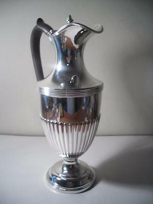 An Antique Ewer Style Silver Claret Jug With Demi Fluting : London 1905
