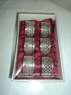 Silver plated and ornate napkin rings set of 6 - boxed
