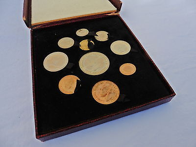 A Maroon Cased Festival Of Britain Coin Set