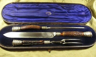 A MAPPIN & WEBB cased carving set, with antler handles, and  silver