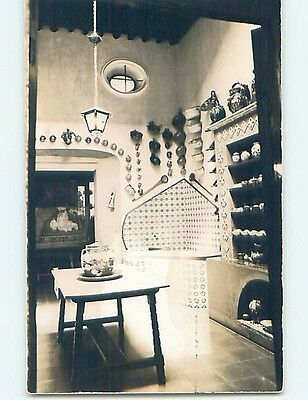 old rppc DISHES HANGING ON WALL AND IN CUPBOARD Taxco - Guerrero Mexico HM1416