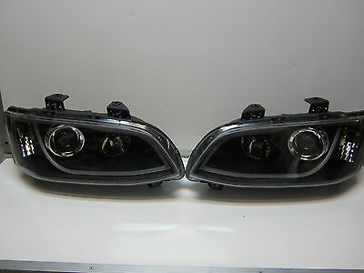 Holden Commodre VE SERIES 1 BLACK LED DRL Projector Headlights Pair New