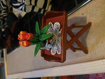 1:12th scale dolls house table and new reutter vase with flowers