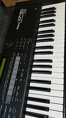 Roland xp 50 keyboard with manual and stand.