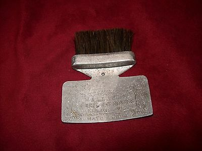 Vintage Metal Clothing Brush, Wallach's Hatters and Furnishers in Oshkosh, WI.