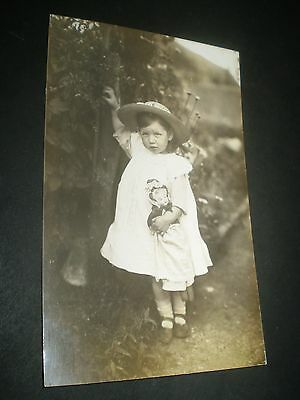 social history edwardian beautiful girl holding doll fashion rp photo postcard