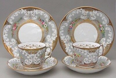 Two Nineteenth Century Cups Saucers And Plates  With Hand Painted Flowers