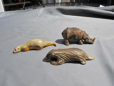 Tremar Pottery models of an otter,a badger and a rhinoceros
