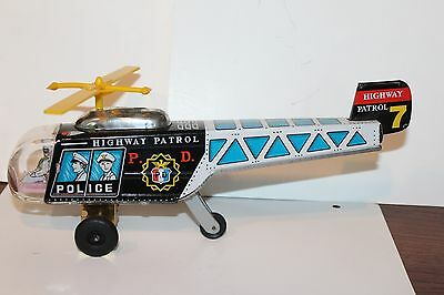 NICE TIN LITHO FRICTION OPERATED #7 HIGHWAY PATROL HELICOPTER with PILOT