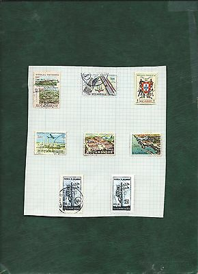 Portugal colonies Mozambique nice lot of MH and used old stamps on album pages