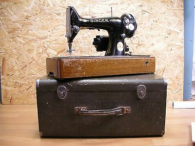 Vintage Singer 99K Sewing Machine circa 1939 with case, manuals and motor.