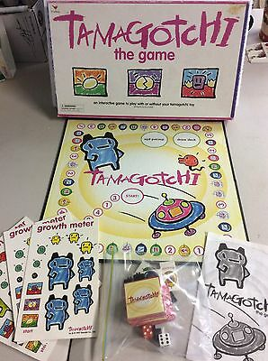 Vintage 1997 TAMAGOTCHI THE GAME Cardinal by Bandai