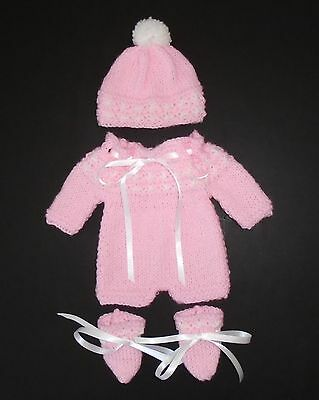 "Hand knitted dolls clothes for a 12""-13"" baby doll"