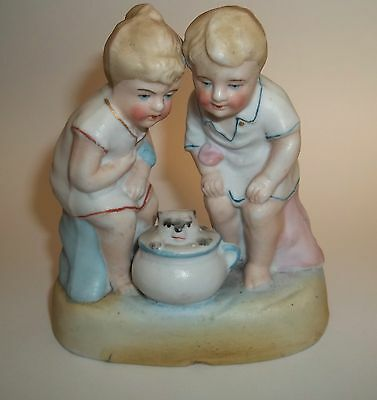 Bisque Potty Figurine Boy And Girl With Kitty In Chamber Pot