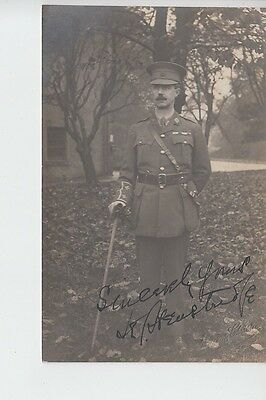 Signed postcard showing Army Officer with stick