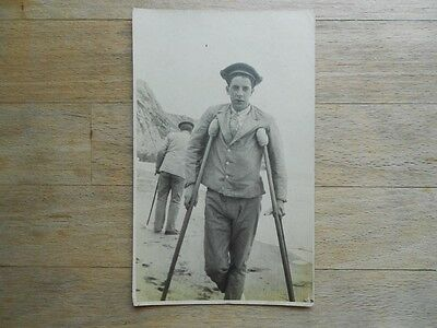 Vintage WW1 era postcard Wounded Soldier/Sailor on Crutches - RP