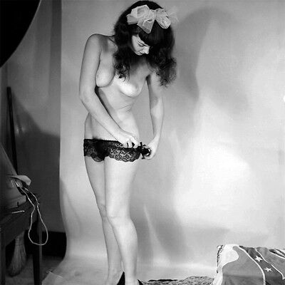 60s Pinup Bettie Page Removing panties in photo studio 8 x 8 Photograph