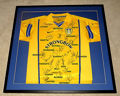 Professionally Framed: Leeds United 2000-01 Champions League Squad Signed Shirt