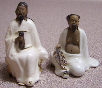 Two Miniature Collectible Mud Man Figurines