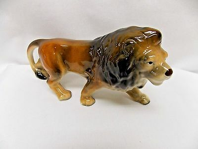 Wild Lion Porcelain Figurine 7 Lx3 1/2T Inch #10136 on Botton Crazing from age