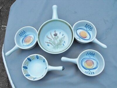 Four  hand decorated Buchan Pottery Scotland skillets and a larger handled dish