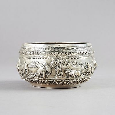 Silver vase with a story frieze on. Burma.