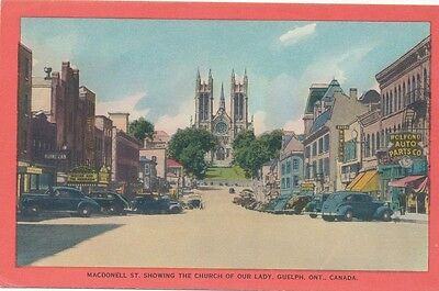 MacDonell St. showing the Church of Our Lady, Guelph, Ont.