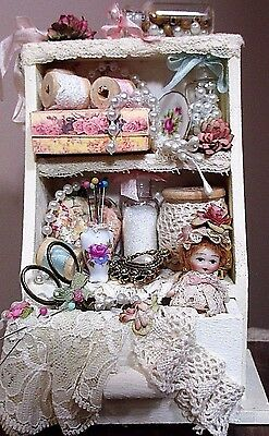 """Tiny 1 1/2"""" All Bisque Kewpie baby doll in Cabinet of dollhouse accessories"""